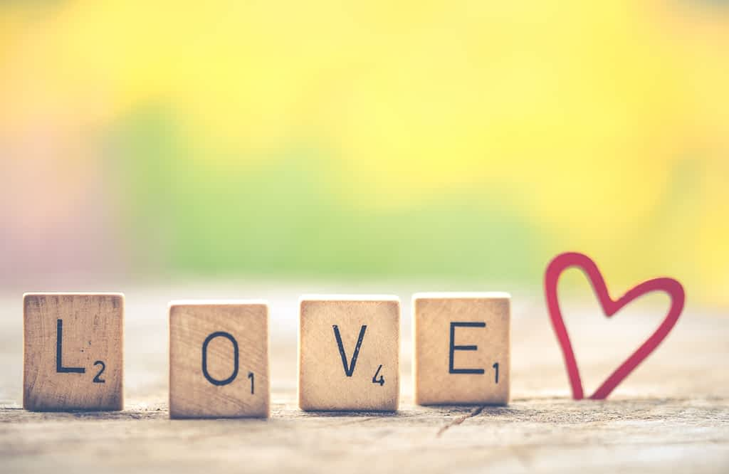 Scrabble tiles formed in the word love