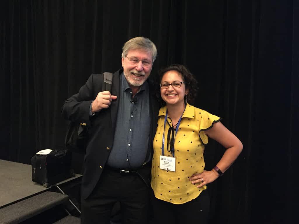 Pantea Rahimian and Dr. Bessel van der Kolk standing side by side at conference