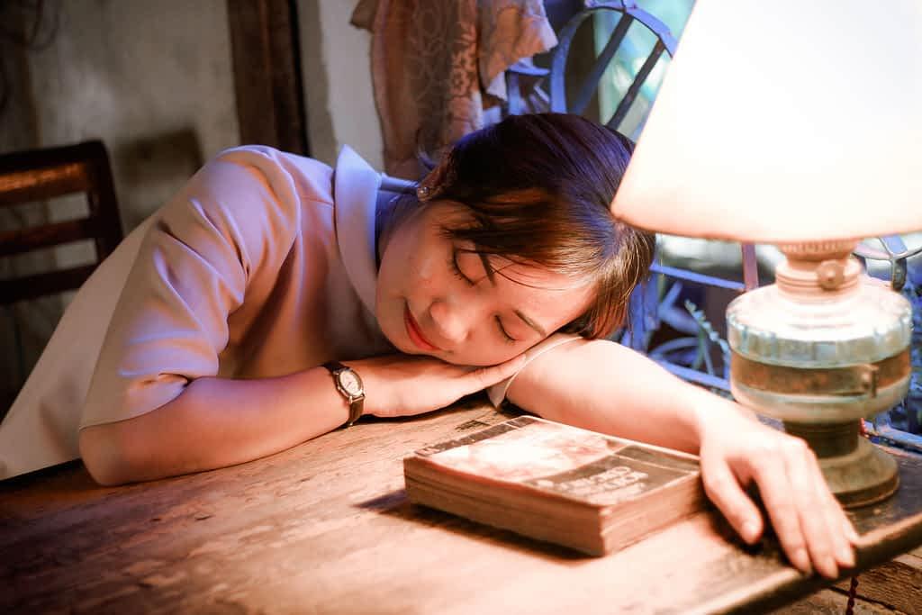 A woman sleeping on her desk