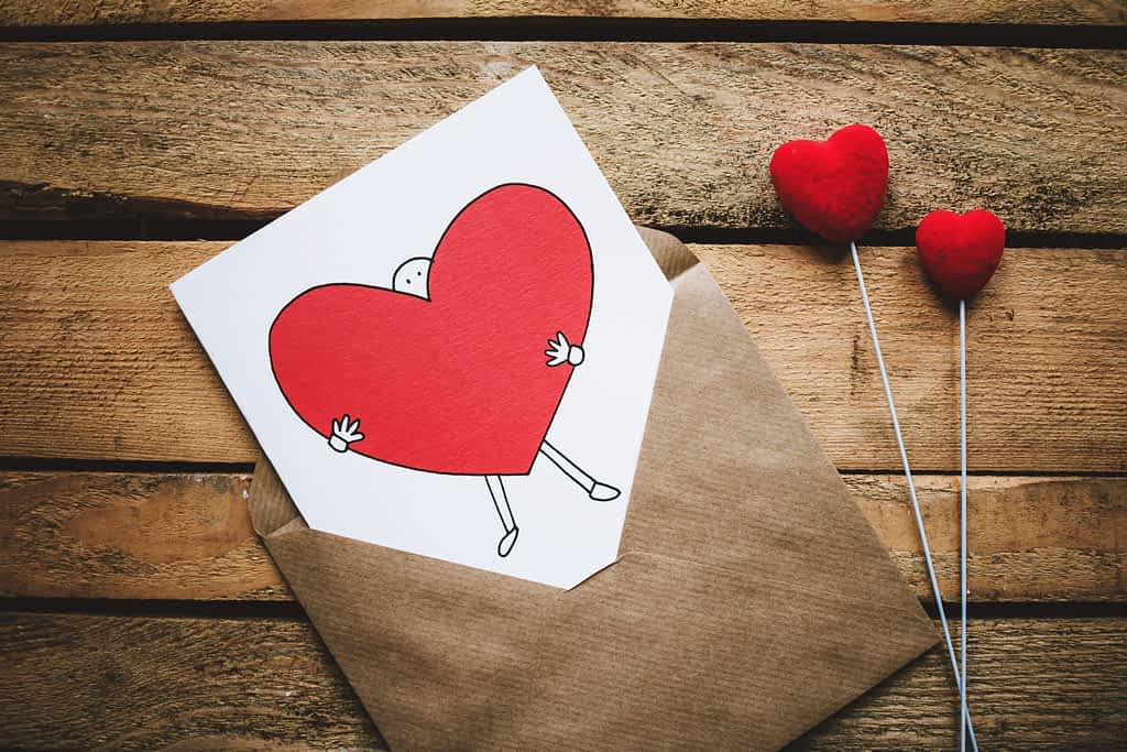 A heart shaped card in an envelope for Valentine's Day