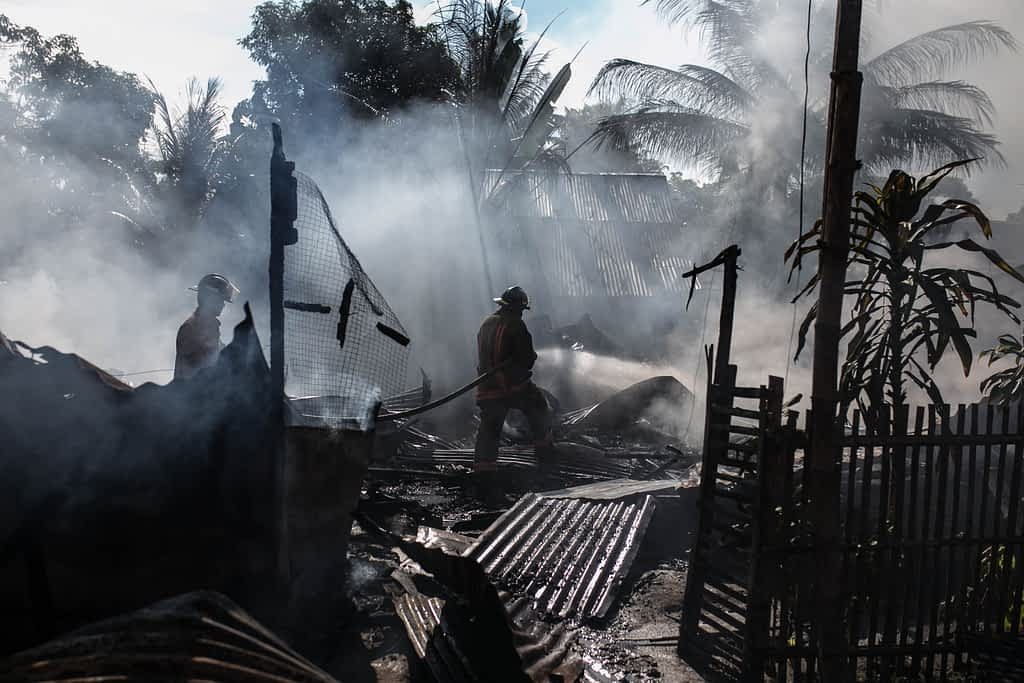 Disaster zone with two firefighters