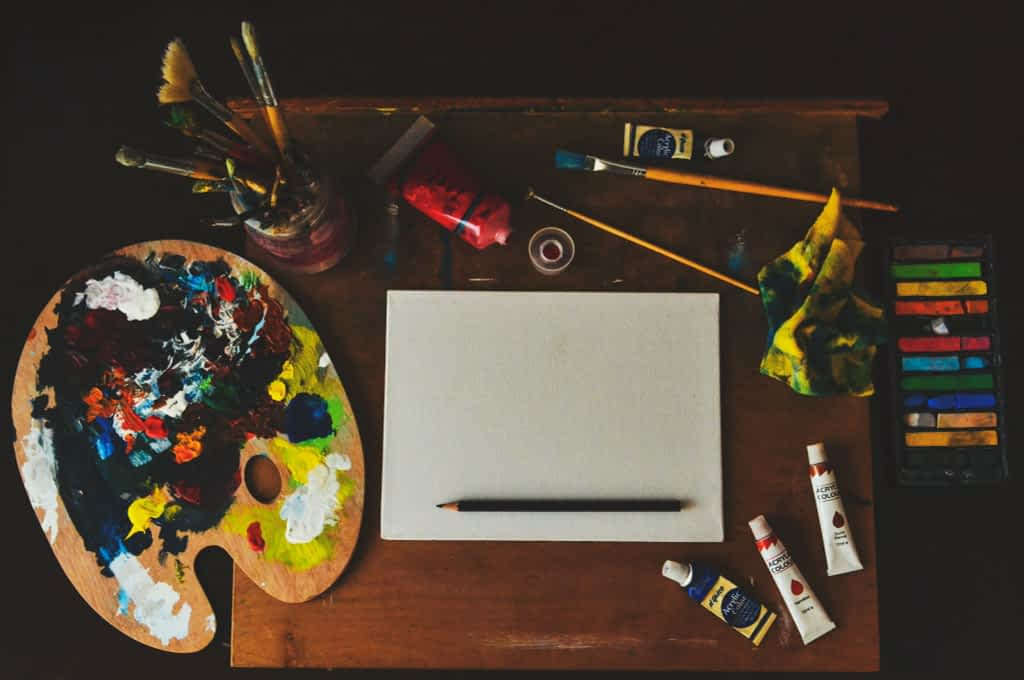 Assorted color artwork equipment on a table