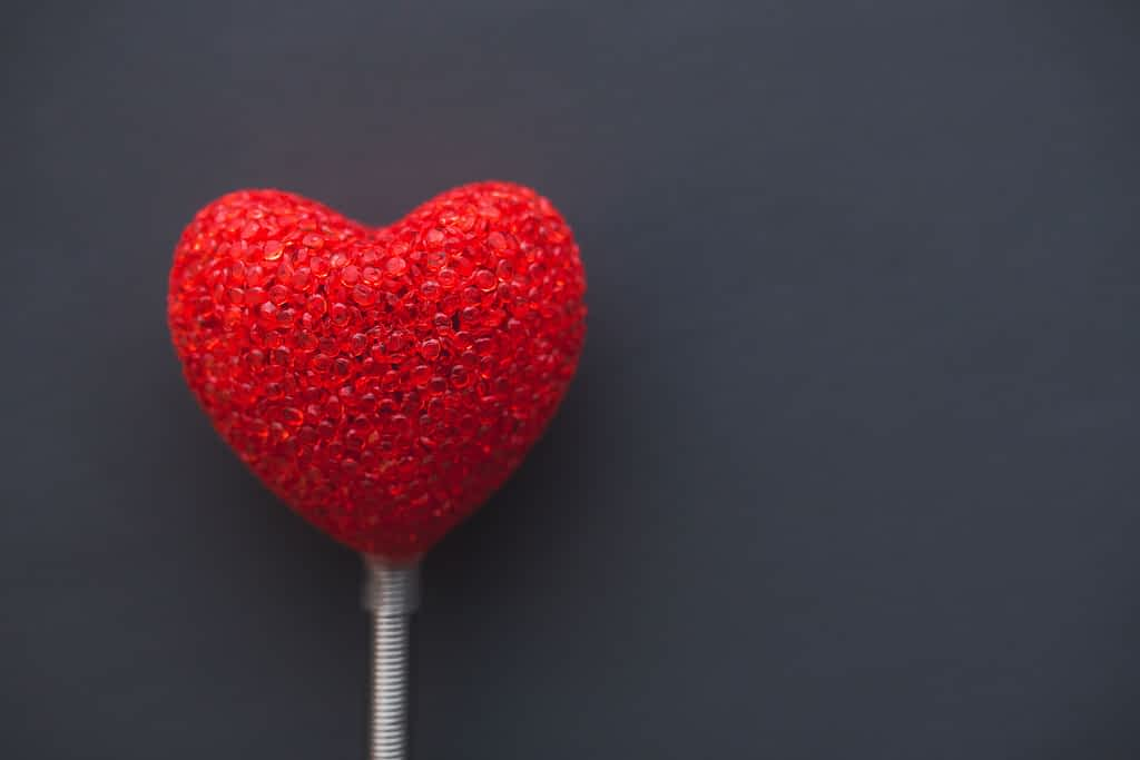 A heart shaped ballon on a stick