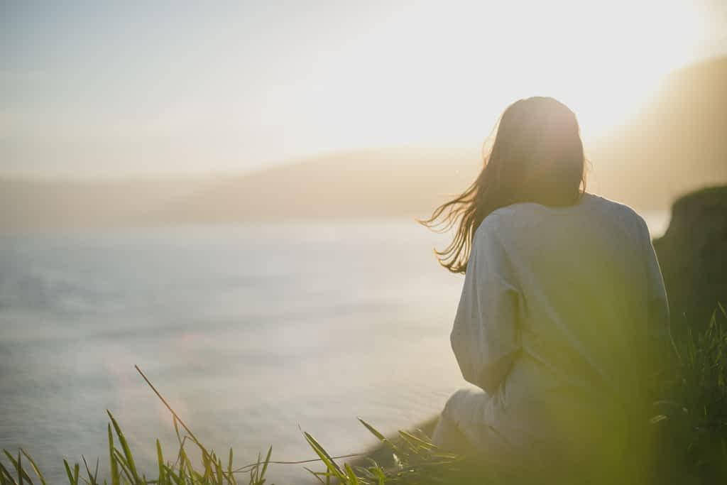 A woman practicing meditation