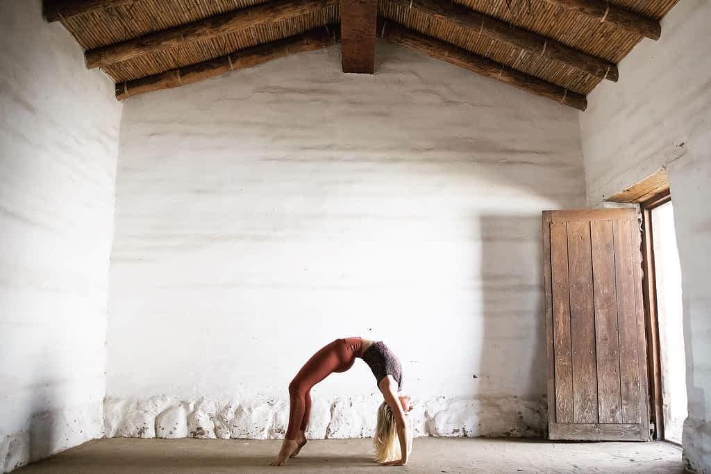Sierra Noland demonstrating yoga wheel pose