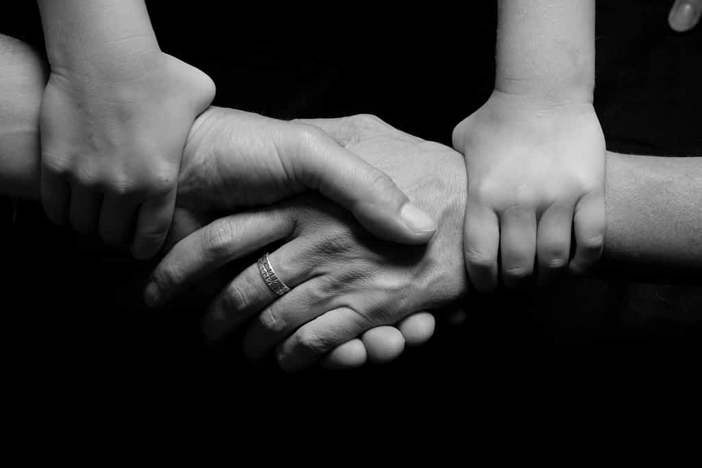 Four pairs of hands