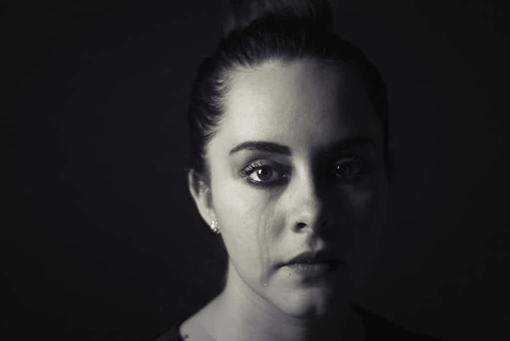 A woman crying and experiencing grief and loss