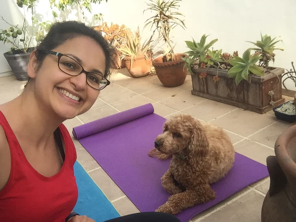 Pantea Rahimian practicing yoga from home with her dog Rylee