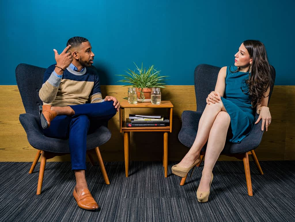 Woman in dress talking to a man