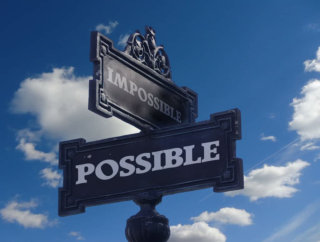 Street sign stating Impossible and possible