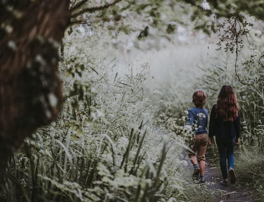Two children walking in nature during the coronavirus lockdown