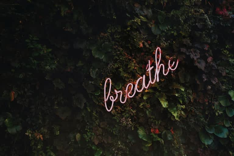 A sign that says breath