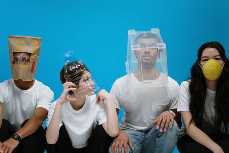 Four people with various types of masks on their face