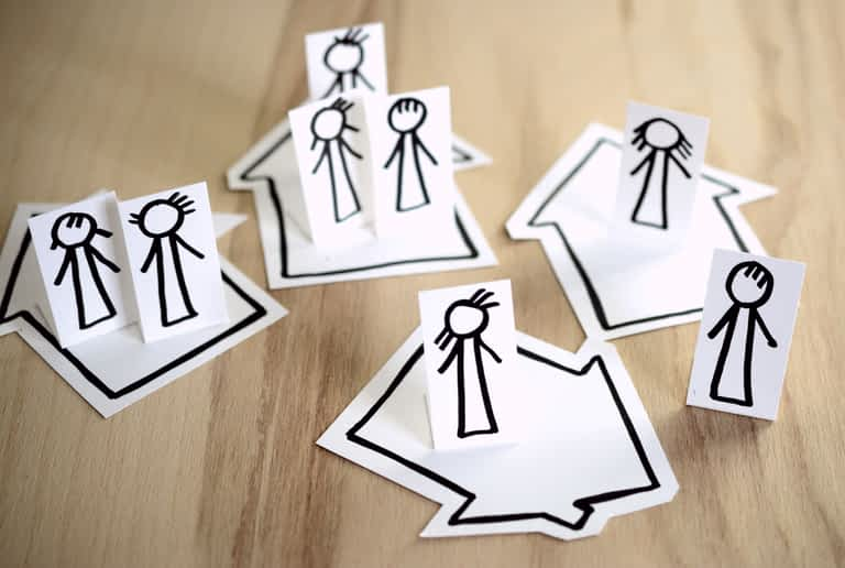 Stick figures in separate homes during the coronavirus lockdown